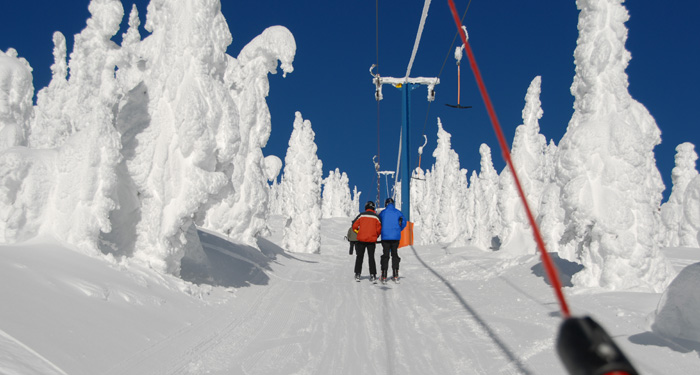 skiers on a drag lift