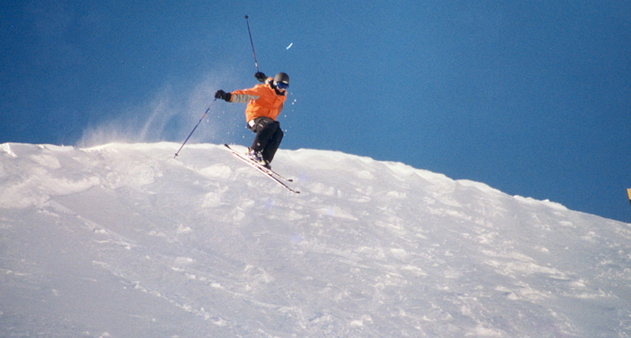 skier jumping in the snow